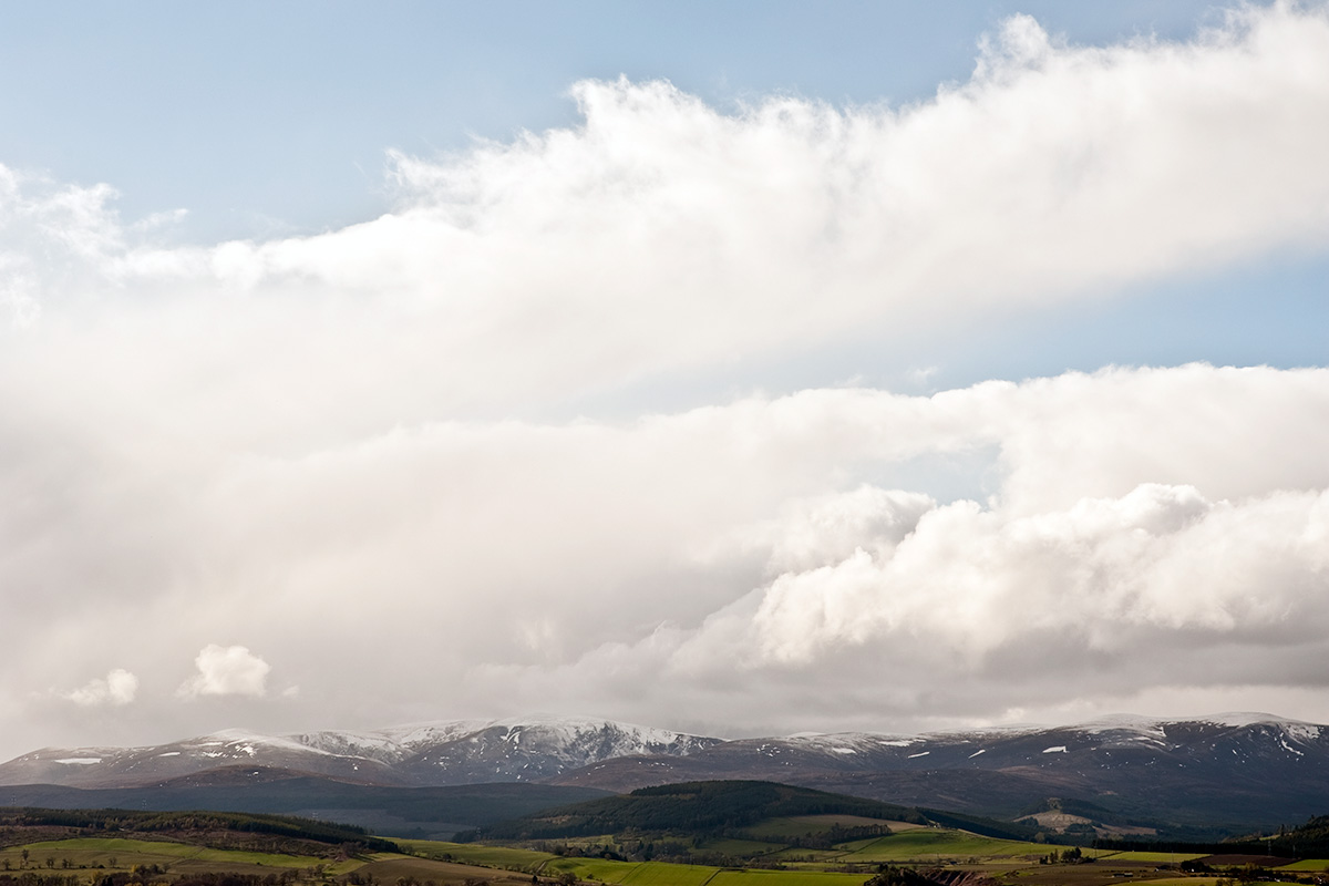 The fields and snow covered peaks of the Black Isle