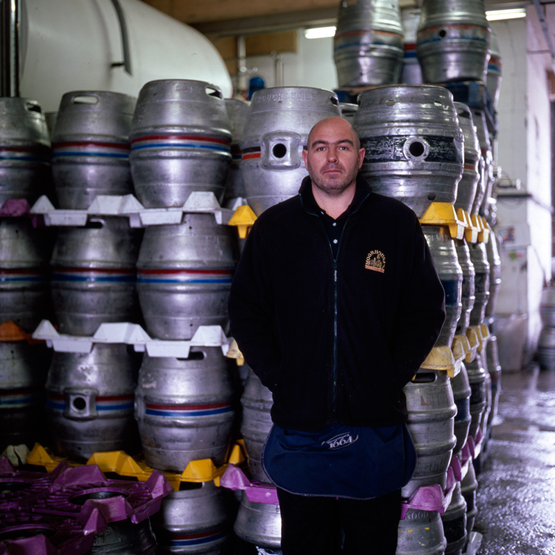 An employee in the old (then current) warehouse at Moorhouse's Brewery