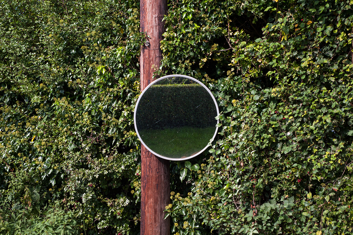 A convex roadside mirror, Alfrick, Worcestershire