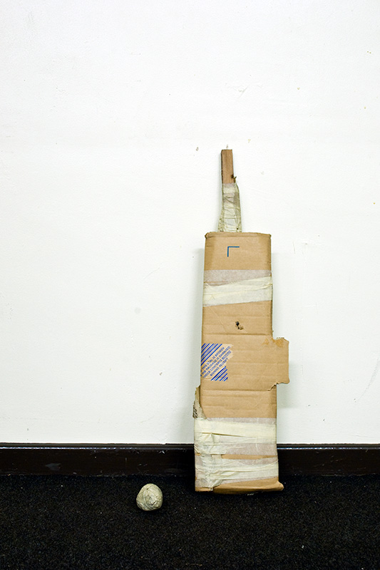 A cricket bat and ball made from packing materials