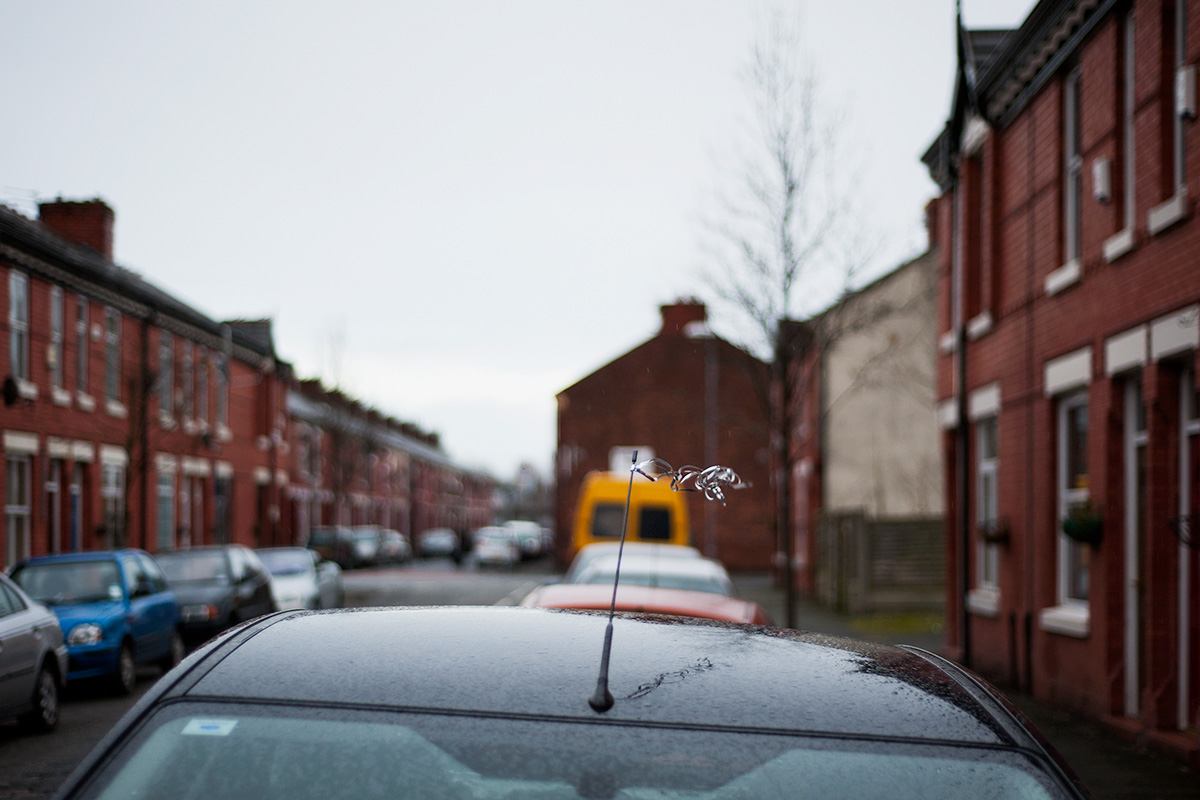 Ribbon tied to a car aerial in Rusholme, Manchester