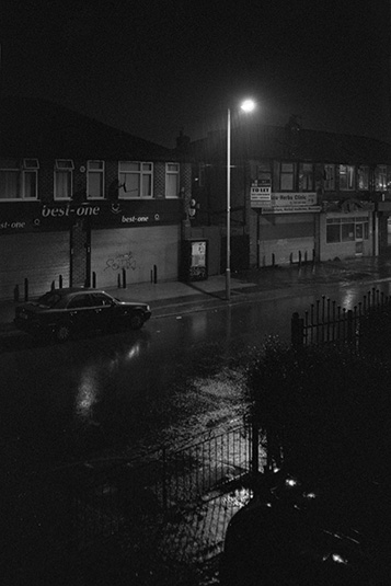 Withington during a thunderstorm, reminiscent of film noir