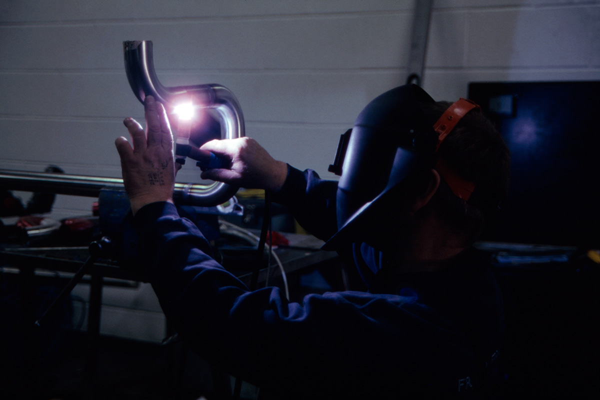 A welder connecting pipes at Moorhouse's new brewery