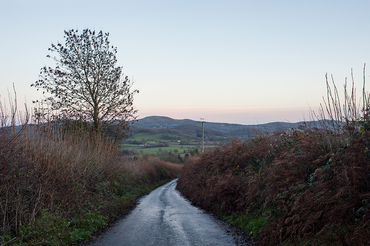 A country lane leading to Great Malvern and West Malvern, with the Malvern Hills beyond