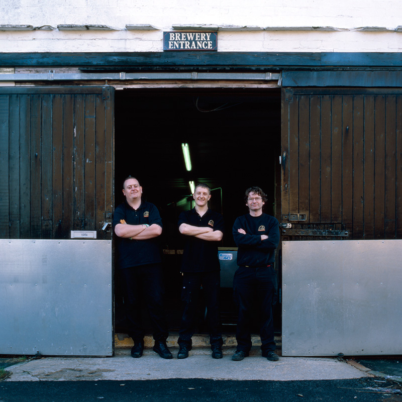 Brewers at the entrance of Moorhouse's old brewery on its final day of operation