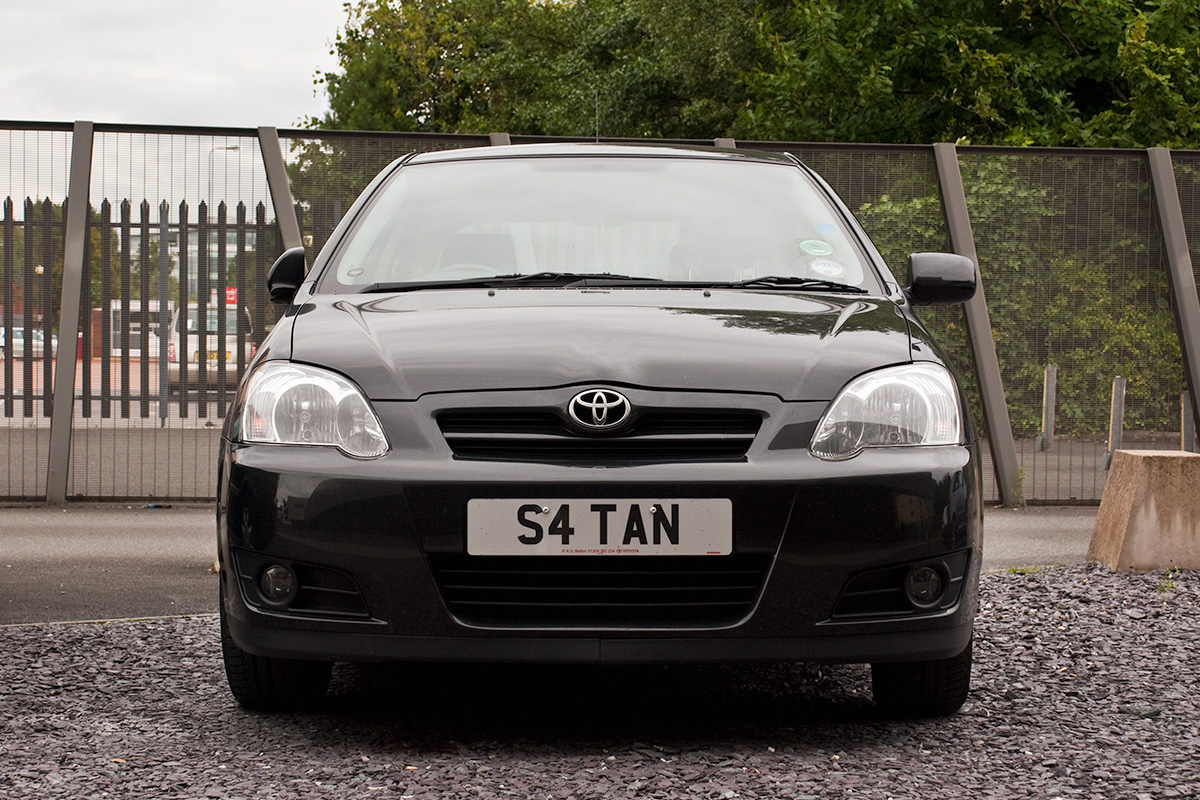 A small car with the number plate S4TAN