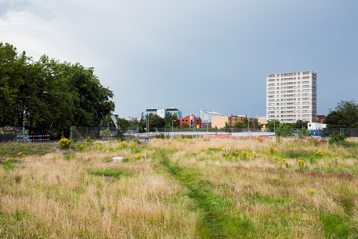 A desire path across the corner of undeveloped land, Hulme, Manchester