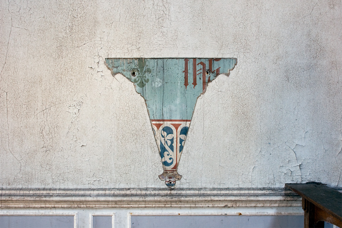 A void in paintwork after the removal of a fixture at Whittingham Asylum