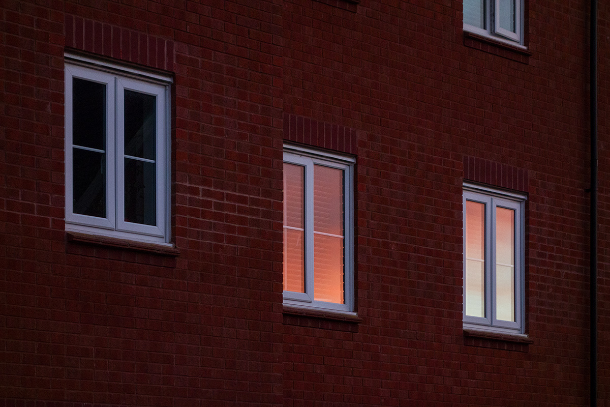 Sunset reflected in house windows
