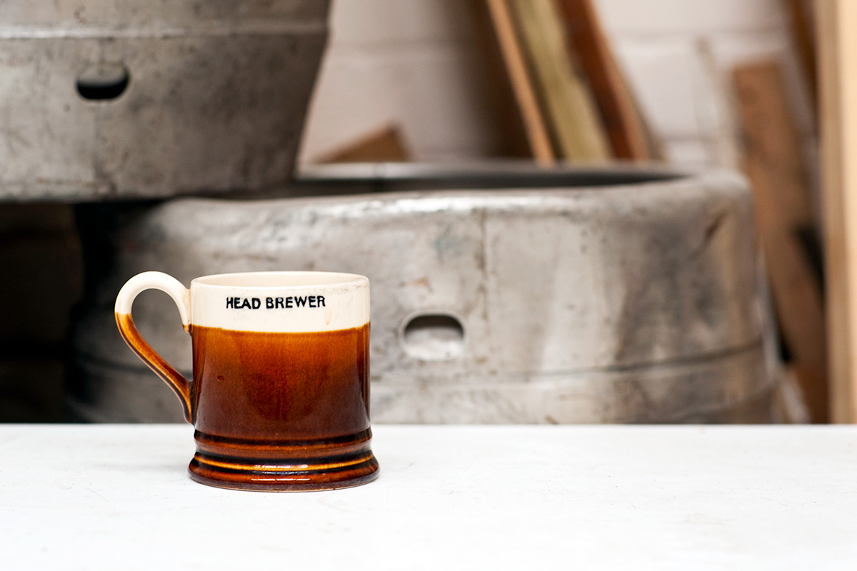 A mug bearing the text Head Brewer at Quantum Brewery, Stockport