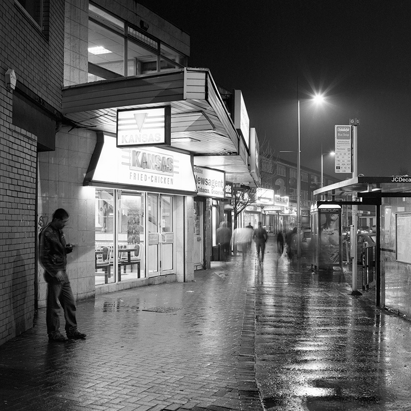 The Curry Mile at night during rain