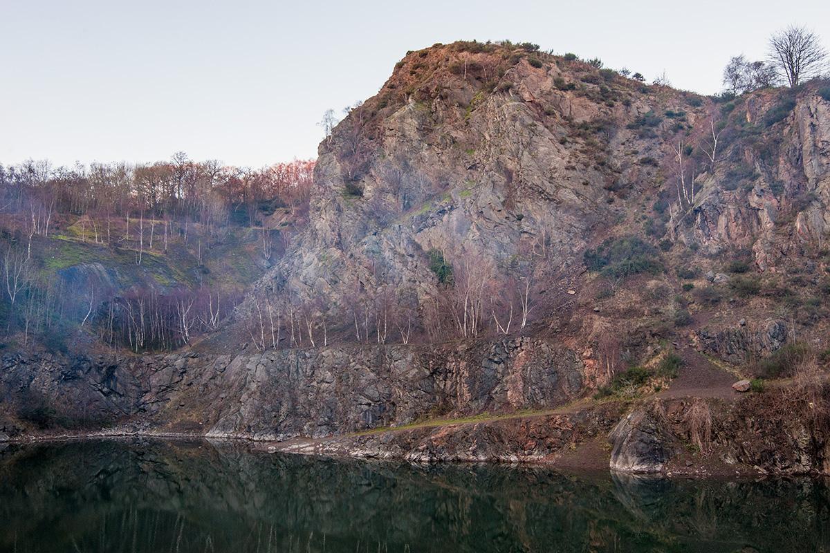 Light woodsmoke drifting across Gullet Quarry