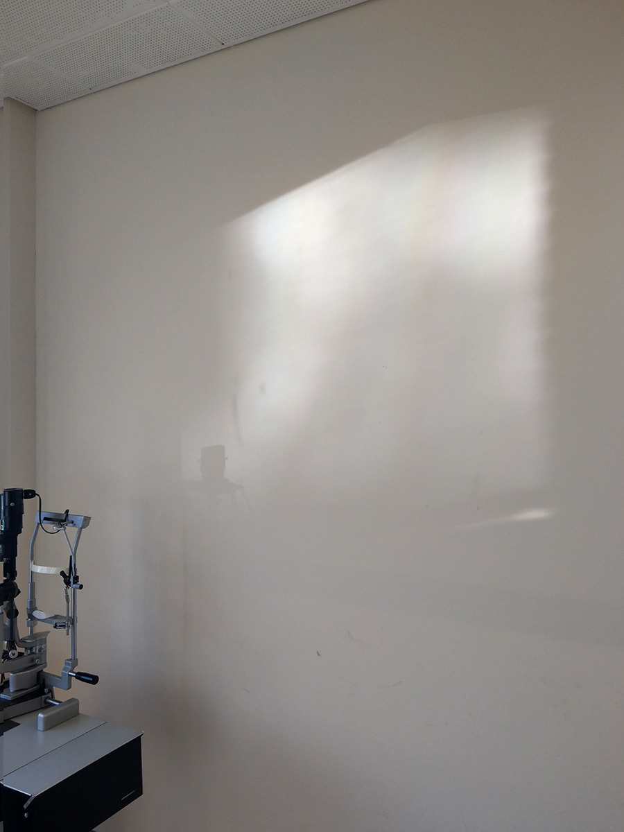 Refracted light on the wall of a clinical room in a hospital