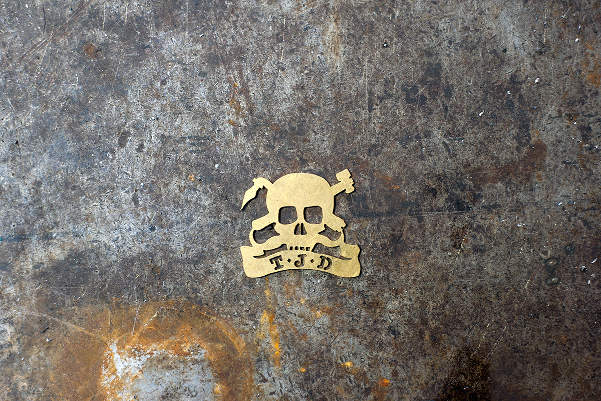 Ted James Design headbadge on a workbench