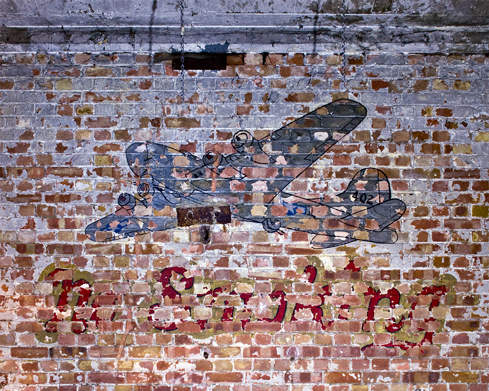 The remnants of a no smoking sign painted on a hangar wall at RAF Burtonwood, later USAF Burtonwood