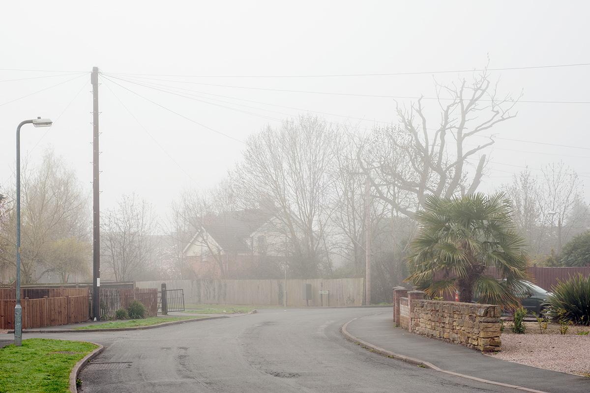 Residential street in Barnards Green in fog