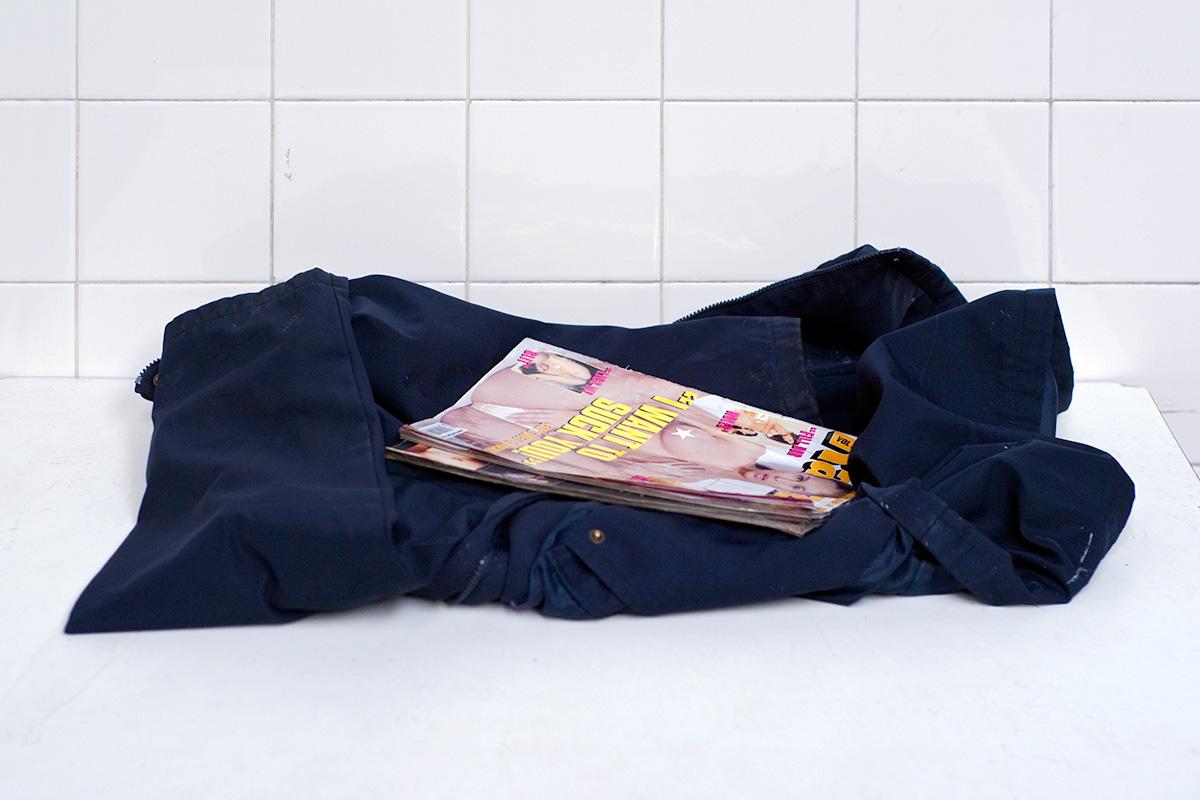A pornographic magazine left atop a folded jacket