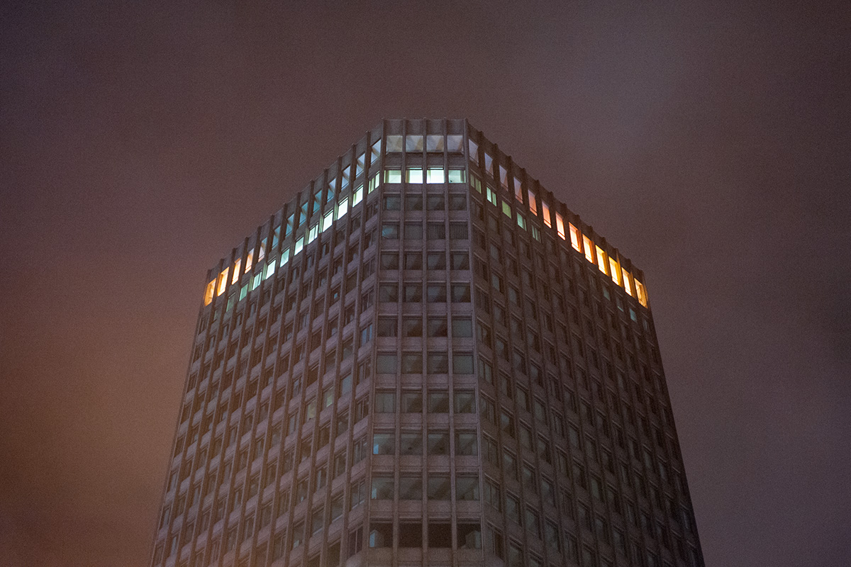 Capital Tower, Cardiff, with light polution illuminating passing rain clouds