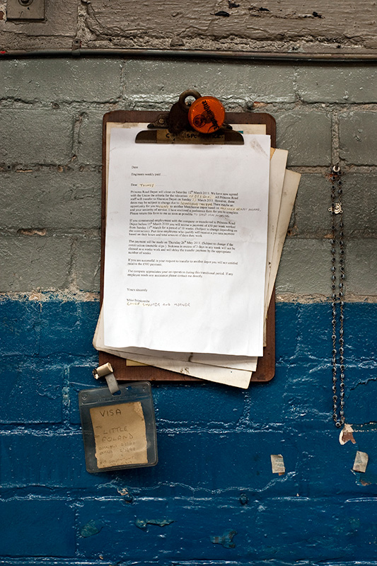 An altered redundancy letter attached to a clipboard, with personal effects