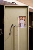 A locker decorated with a postcard of Jesus