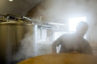 Steam from the mash tun enveloping Colin Stronge at Marble Beer's new brewery