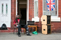A man DJing at a Jubilee street party in Rusholme, Manchester