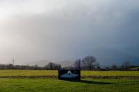 An alien face-in-hole board in a field near Worcester